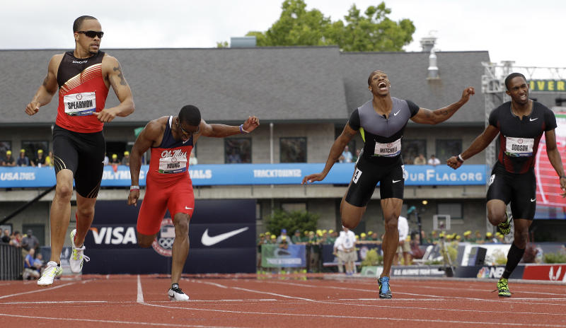 Wallace Spearmon Jr., left, Isiah Young, second from left, and Maurice Mitchell, second from right, finish the men's 200 meter final at the U.S. Olympic Track and Field Trials Sunday, July 1, 2012, in Eugene, Ore. Spearmon finished first, Mitchell came in second and Young finished third. Jeremy Dodson is at right. (AP Photo/Eric Gay)