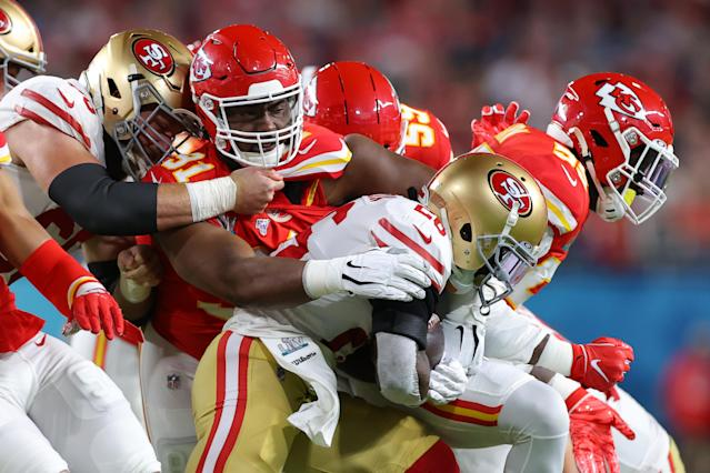 MIAMI, FLORIDA - FEBRUARY 02: Tevin Coleman #26 of the San Francisco 49ers is tackled by Derrick Nnadi #91 of the Kansas City Chiefs in the first quarter in Super Bowl LIV at Hard Rock Stadium on February 02, 2020 in Miami, Florida. (Photo by Kevin C. Cox/Getty Images)