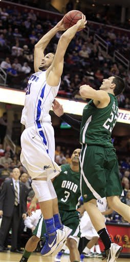 Buffalo's Mitchell Watt (21) dunks the ball in front of Ohio's Ivo Baltic in the first half during an NCAA college basketball game in the Mid-American Conference men's semifinals Friday, March 9, 2012, in Cleveland. (AP Photo/Tony Dejak)