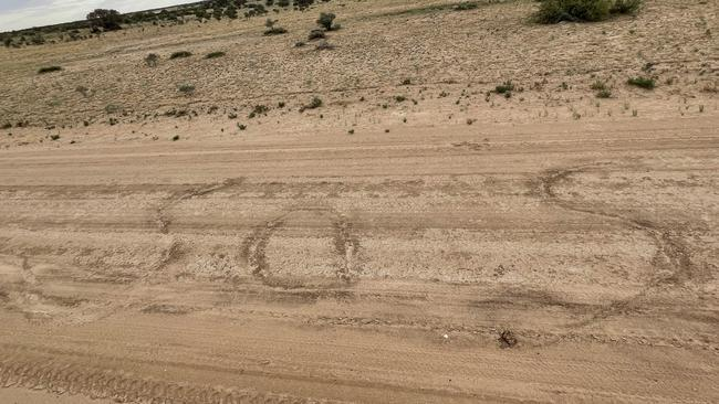 The couple wrote a giant SOS in the dirt. Source: Royal Flying Doctor Service