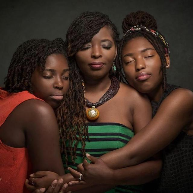 The author, center, and her daughters. (Photo: Erskine Isaac)