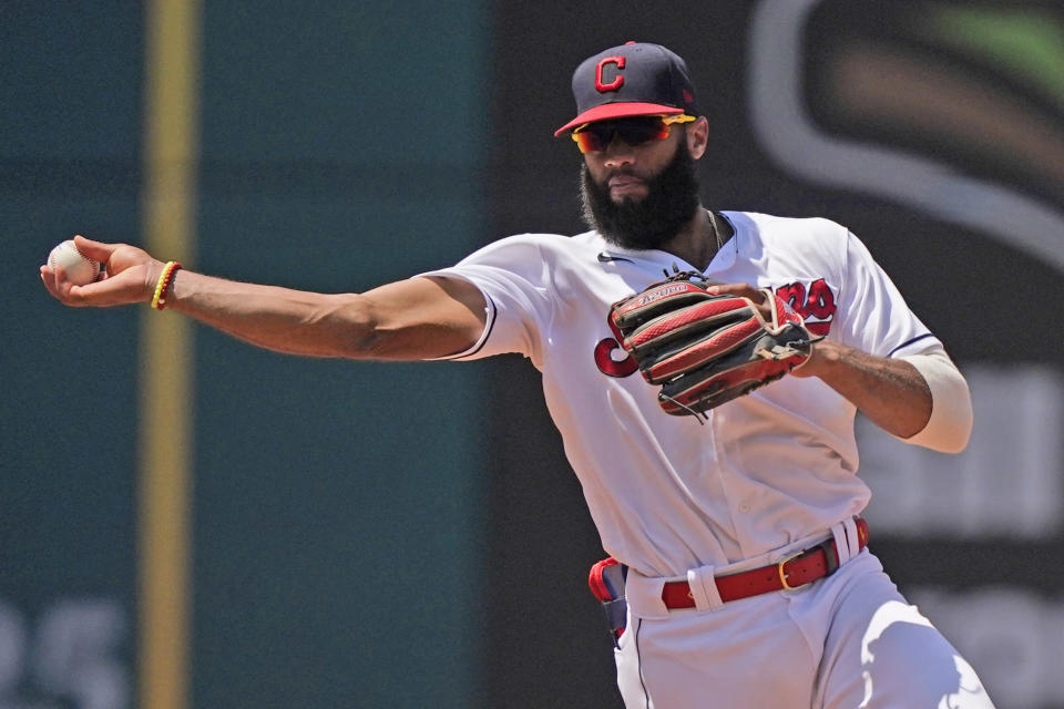 Cleveland Indians' Amed Rosario throws out Tampa Bay Rays' Randy Arozarena at first base in the fifth inning of a baseball game, Sunday, July 25, 2021, in Cleveland. (AP Photo/Tony Dejak)