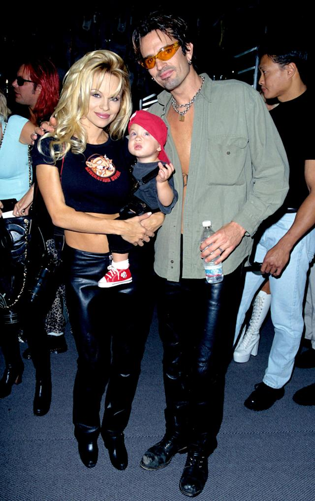 Pamela Anderson, Tommy Lee, and their son Brandon at the Guitar Center in Hollywood in 1997. (Photo: S. Granitz/WireImage)