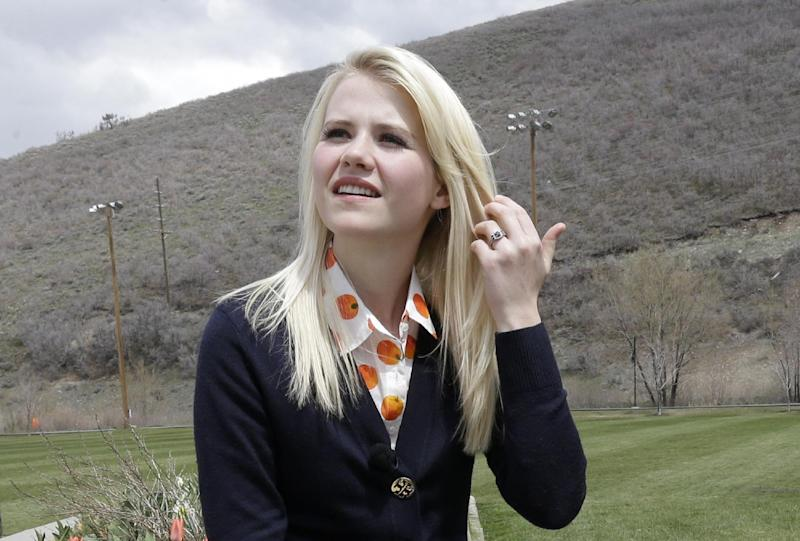 "FILE - In this May 7, 2013, file photo, Elizabeth Smart talks with a reporter before an interview in Park City, Utah. More than a decade after her kidnapping and rescue grabbed national headlines, Smart is publishing a memoir of her ordeal. The 308 page book, titled ""My Story,"" is being released by St. Martin's Press on Monday, Oct. 7, 2013. (AP Photo/Rick Bowmer, File)"