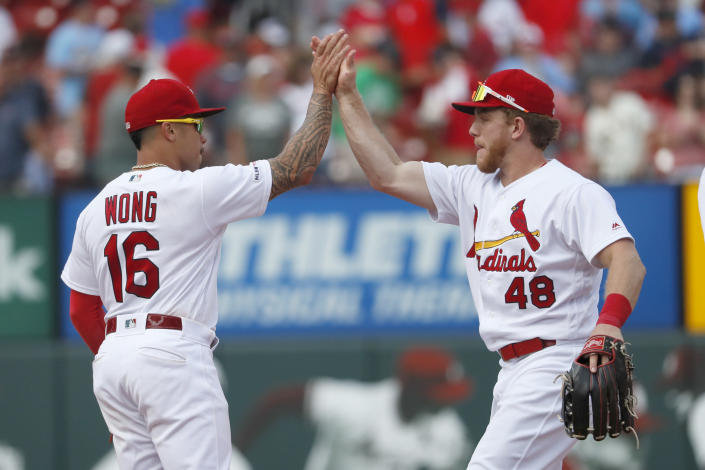 St. Louis Cardinals' Kolten Wong (16) and Harrison Bader (48) celebrate a victory over the San Francisco Giants in a baseball game Monday, Sept. 2, 2019, in St. Louis. (AP Photo/Jeff Roberson)