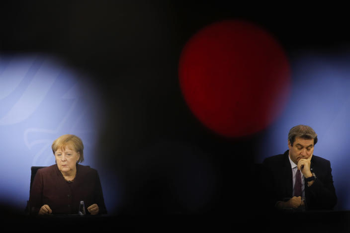 FILE - In this file photo dated Wednesday, Feb. 10, 2021, German Chancellor Angela Merkel, left, and Bavarian state governor Markus Soeder, right, attend a news conference after a meeting at the chancellery in Berlin, Germany. The 54-year-old Soeder is fighting to win enough backing across the political spectrum in hope of succeeding Angela Merkel as chancellor of Germany in Autumn 2021. (AP Photo/Markus Schreiber, FILE)