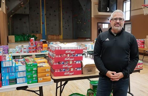 David Sawler, executive director of Undercurrent Youth Centre, stands in the centre's gym where lunches are put together for local youth in this file photo from July 2020.  (Brittany Wentzell/CBC - image credit)