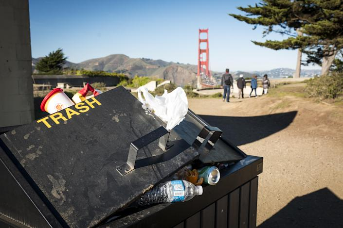 Full garbage cans sit at Golden Gate National Recreation Park in San Francisco, California, on Jan. 2, 2019. (Photo: David Paul Morris/Bloomberg via Getty Images)