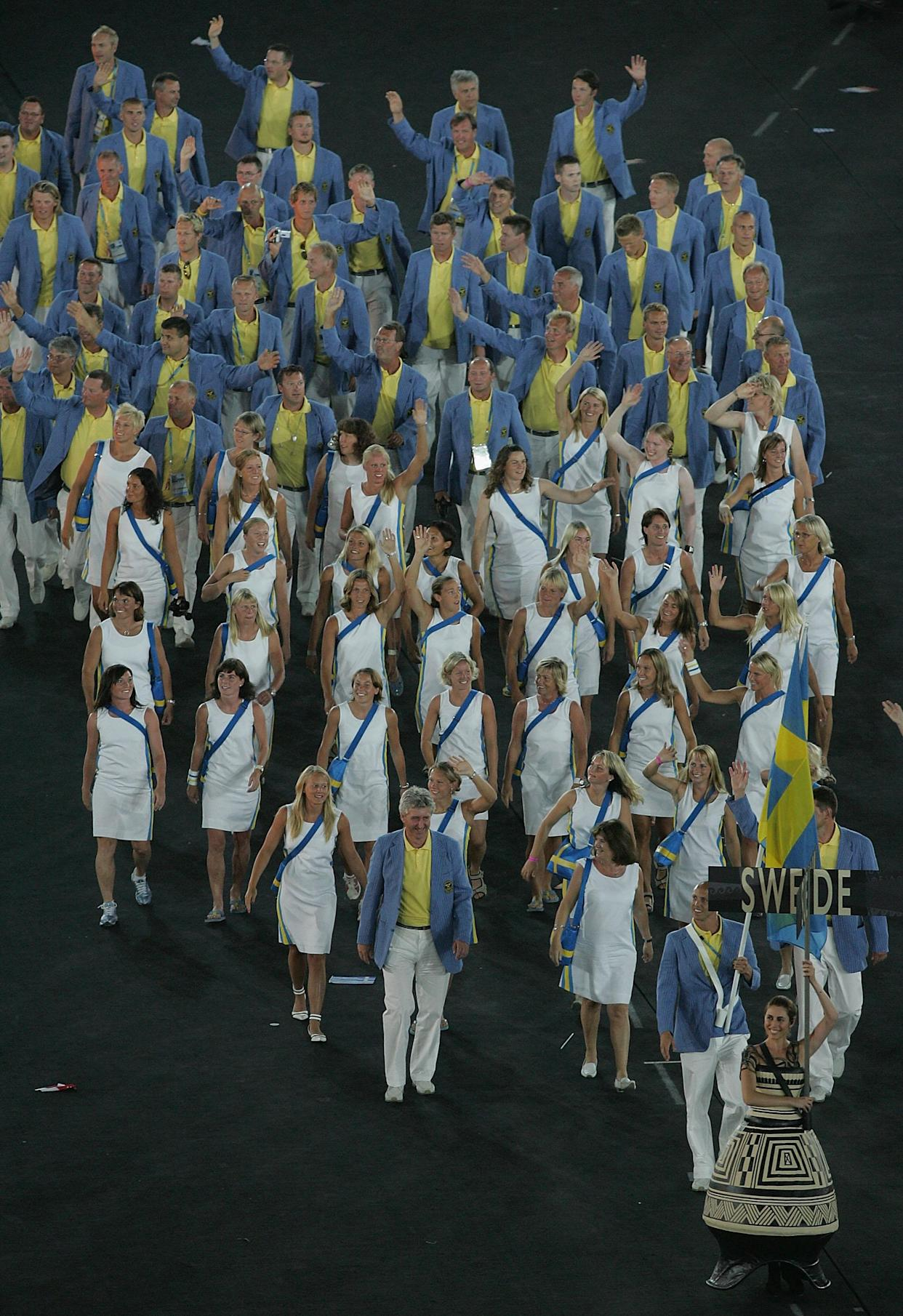 ATHENS - AUGUST 13:  Flag bearer Lars Frolander leads team Sweden during the opening ceremony of the Athens 2004 Summer Olympic Games on August 13, 2004 at the Sports Complex Olympic Stadium in Athens, Greece.  (Photo by Jonathan Ferrey/Getty Images)