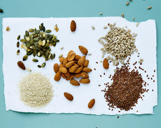 """<p>These handy grab-and-go foods are another great source of omega 3s as well as vitamin B. Consuming omega-3s """"positively influence your behavior, attention span, mental activity, brain development, and function,"""" registered dietitian Trishna Joshi, the lead nutritionist at Fresh Diet, tells Yahoo Health. """"Vitamin B is critical for focus, energy and concentration, helps you feel good and fuels your body with the energy and concentration."""" <br /></p><p><i>(Photo: Getty Images)</i></p>"""