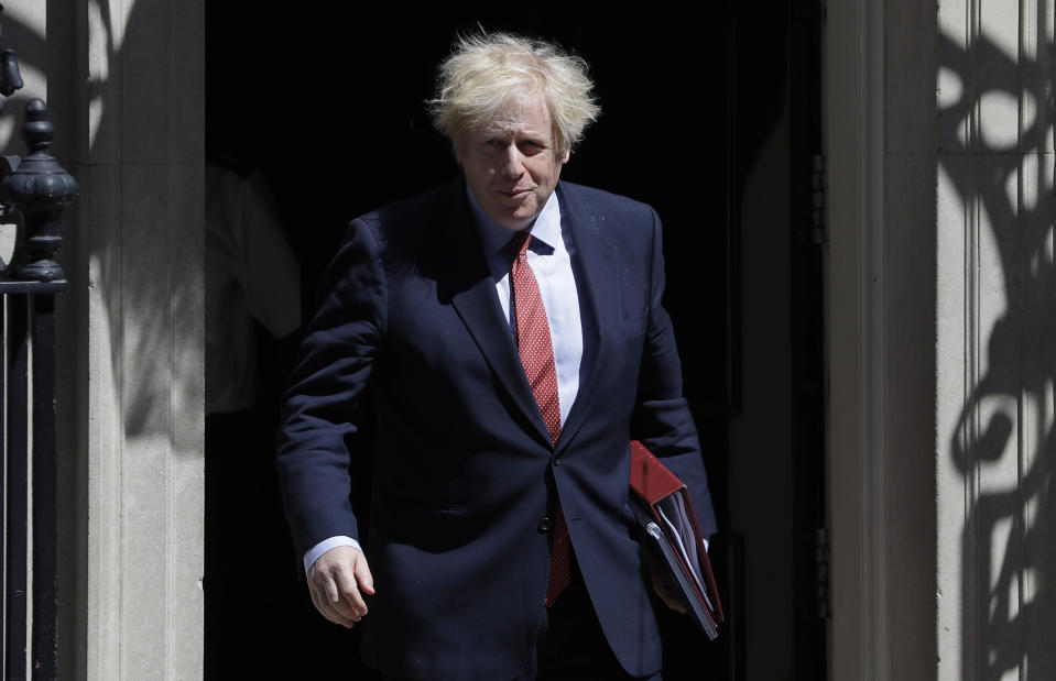 Britain's Prime Minister Boris Johnson leaves Downing Street to attend the weekly session of PMQs in Parliament in London as the country continues its lockdown to help stop the spread of coronavirus, Wednesday, May 20, 2020. (AP Photo/Kirsty Wigglesworth)