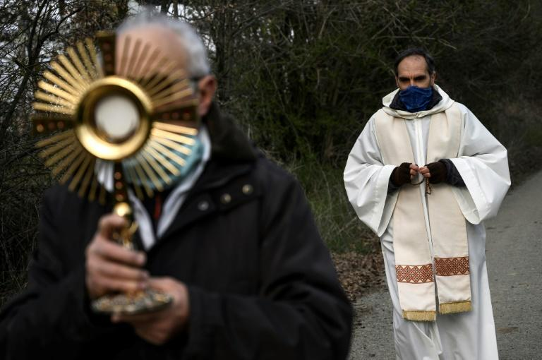 A total of 67 priests have died of the new coronavirus (AFP Photo/MARCO BERTORELLO)