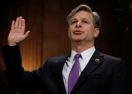 Wray is sworn in prior to testifying before Senate Judiciary Committee confirmation hearing on Capitol Hill in Washington