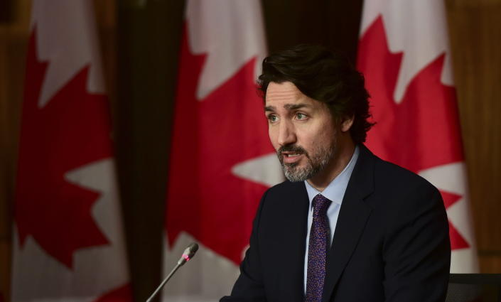 In this April 23, 2021 photo, Canada Prime Minister Justin Trudeau speaks during a news conference in Ottawa. Drug maker Pfizer says, Friday, April 30, it will start sending U.S.-produced COVID-19 vaccines to Canada next week. It's the first time the U.S. has allowed that company's vaccine exported north. (Sean Kilpatrick/The Canadian Press via AP, File)