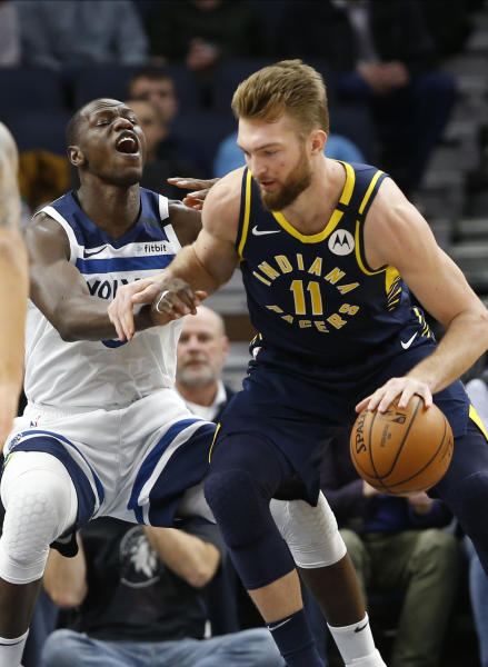 Indiana Pacers' Domantas Sabonis, right, of Lithuania, drives around Minnesota Timberwolves' Gorgui Dieng of Senegal in the first half of an NBA basketball game Wednesday, Jan. 15, 2020, in Minneapolis. (AP Photo/Jim Mone)