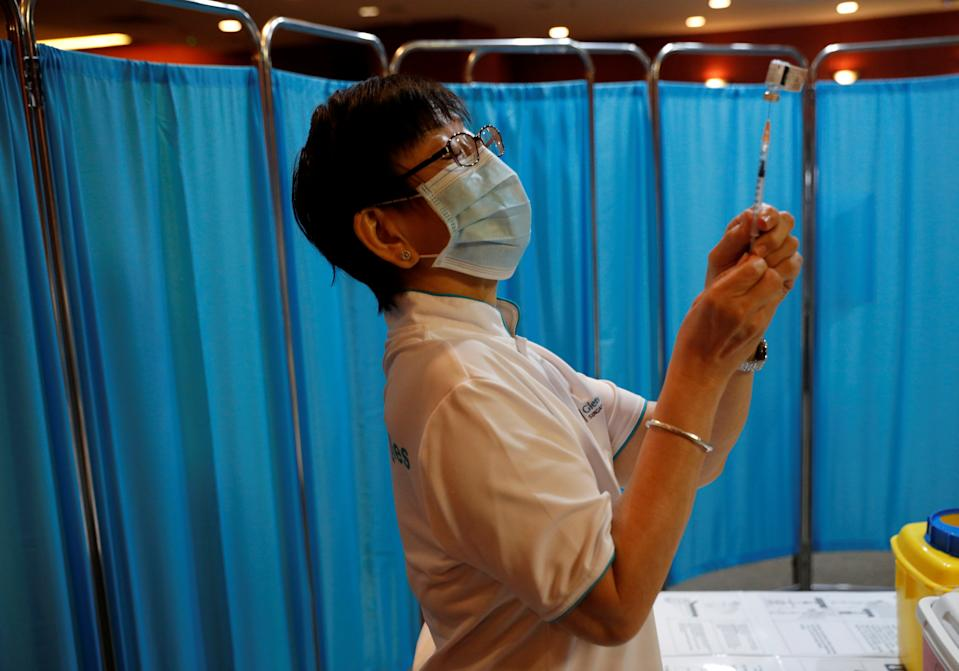 A nurse prepares to vaccinate healthcare workers at Gleneagles hospital in Singapore.
