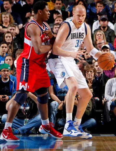 DALLAS, TX - NOVEMBER 14: Chris Kaman #35 of the Dallas Mavericks posts up against Kevin Seraphin #13 of the Washington Wizards on November 14, 2012 at the American Airlines Center in Dallas, Texas. (Photo by Glenn James/NBAE via Getty Images)