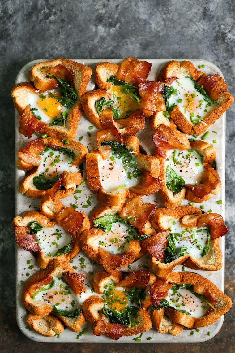 """<strong>Get the <a href=""""https://damndelicious.net/2018/08/17/bacon-and-egg-toast-cups/"""" target=""""_blank"""" rel=""""noopener noreferrer"""">Bacon and Egg Toast Cups</a> recipe from Damn Delicious.</strong>"""