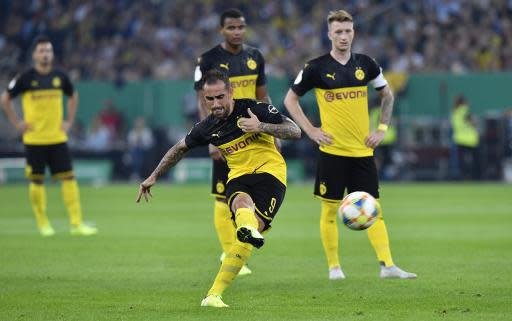 Dortmund's Paco Alcacer scores his side's second goal with free kick during the German soccer cup, DFB Pokal, first Round match between KFC Uerdingen 05 and Borussia Dortmund in Duesseldorf, Germany, Friday, Aug.9, 2019. (AP Photo/Martin Meissner)