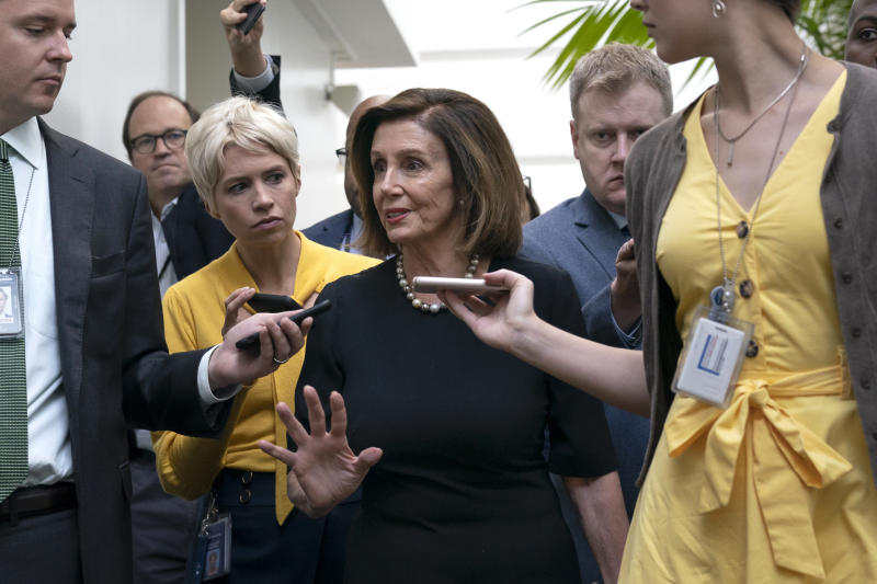 Speaker of the House Nancy Pelosi, D-Calif., is surrounded by reporters as she arrives to meet with her caucus the morning after declaring she will launch a formal impeachment inquiry against President Donald Trump, at the Capitol in Washington, Wednesday, Sept. 25, 2019. (Photo: J. Scott Applewhite/AP)
