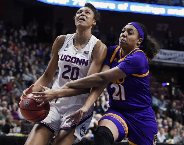 East Carolina's Salita Greene, right, fouls Connecticut's Olivia Nelson-Ododa, left, during the first half of an NCAA college basketball game in the American Athletic Conference tournament quarterfinals, Saturday, March 9, 2019, at Mohegan Sun Arena in Uncasville, Conn. (AP Photo/Jessica Hill)