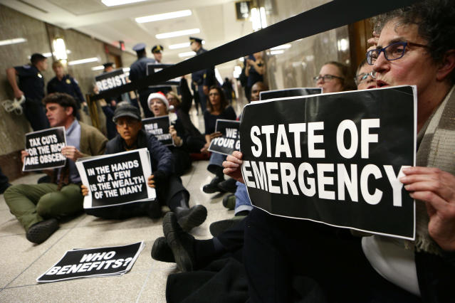 <p>Protesters block the halls outside of the Senate Budget Committee markup of the FY2018 Budget reconciliation legislation in Washington, Nov. 28, 2017. (Photo: Joshua Roberts/Reuters) </p>