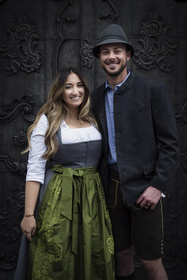 Kris Bryant and his wife, Jessica, pose in traditional Austrian clothes while on vacation in Salzburg. (Photo via Red Bull)