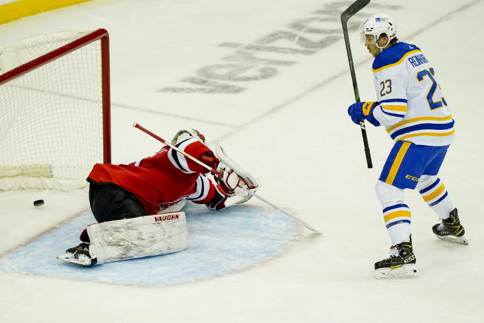 Buffalo Sabres center Sam Reinhart (23) reacts after he scores on New Jersey Devils goaltender Mackenzie Blackwood (29) for a second time in the second period of an NHL hockey game, Saturday, Feb. 20, 2021, in Newark, N.J. (AP Photo/John Minchillo)