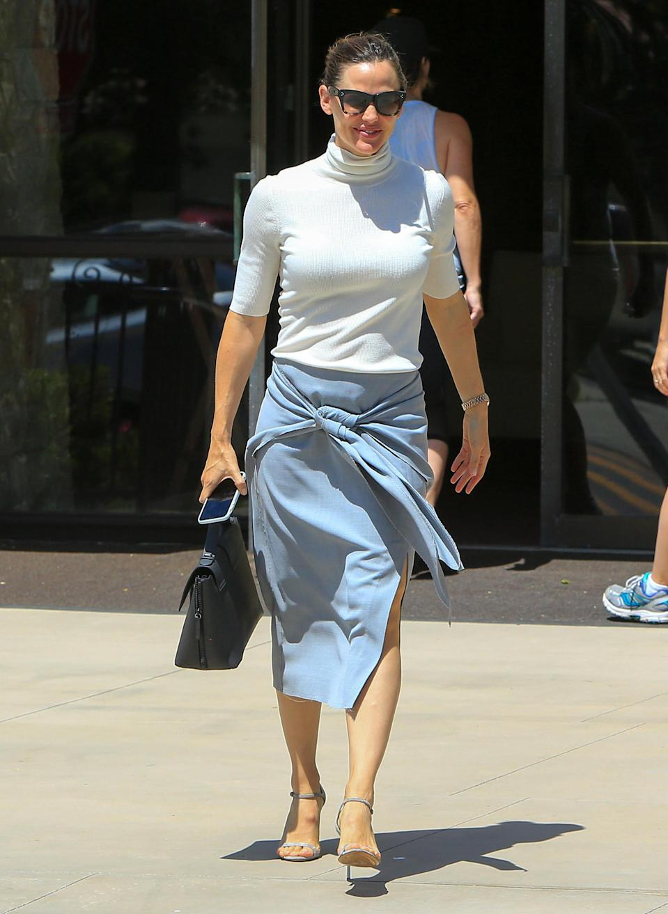 <p>We wish we saw more of Jennifer Garner if these are the sort of looks we can expect. While attending a church service in LA, the actress looked chic in a short-sleeve jumper and grey-blue pencil skirt. <br><em>[Photo: Getty]</em> </p>