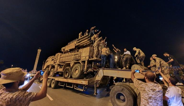 Forces loyal to Libya's UN-recognised Government of National Accord (GNA) parade a Russian-made Pantsir air defence system in Tripoli on May 20 -- seized during one of the recent military successes against Khalifa Haftar's troops