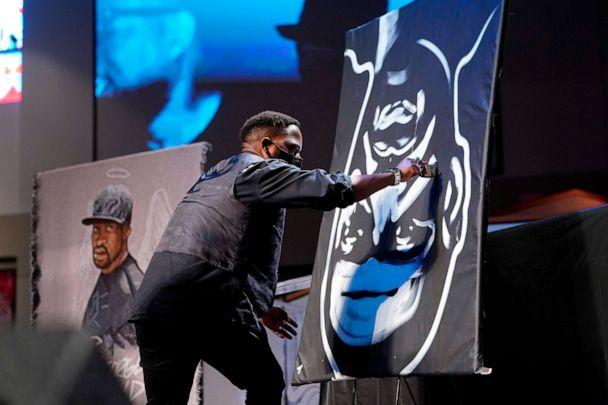 PHOTO: A man draws an image of George Floyd during the funeral service for Floyd at The Fountain of Praise Church on June 9, 2020, in Houston. (David J. Phillip/Pool/AFP via Getty Images)
