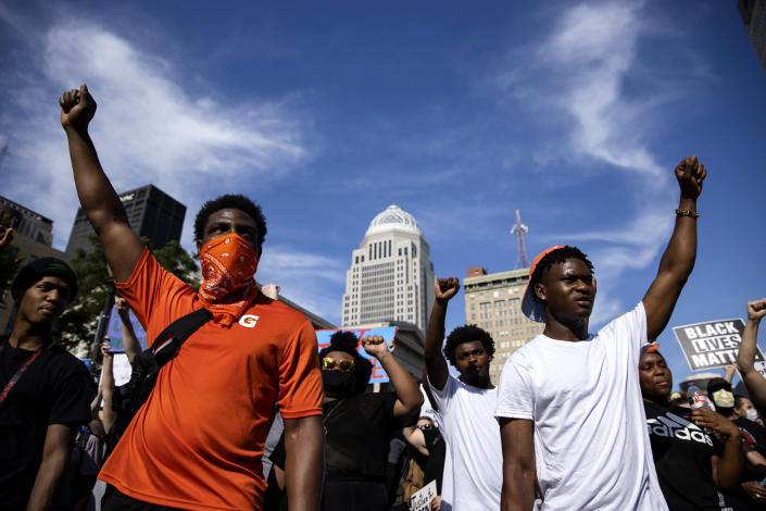 Image: Protesters march through downtown Louisville on June 5, 2020. (Brett Carlsen / Getty Images file)