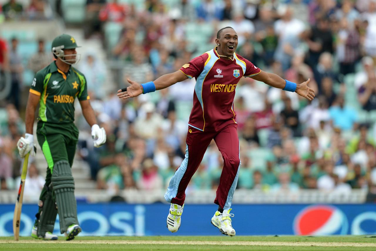 West Indies' Dwayne Bravo (right) celebrates running out Pakistan's Wahab Riaz (left) during the ICC Champions Trophy match at The Oval, London.