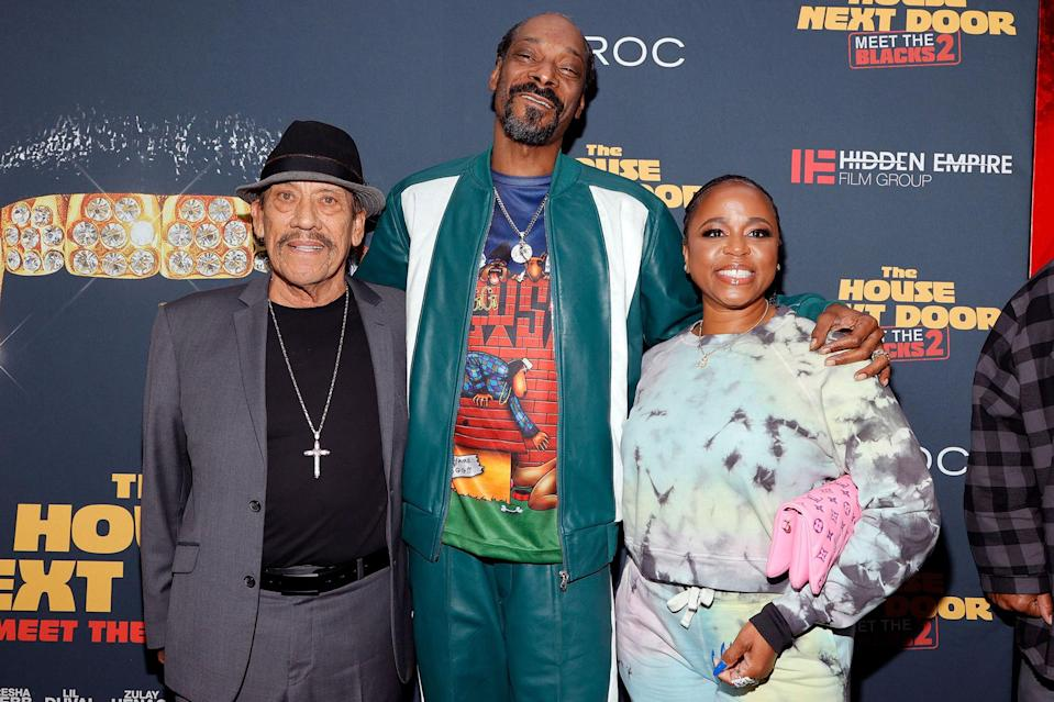 <p>Danny Trejo, Snoop Dogg and wife Shante Broadus pose at the premiere of <em>The House Next Door: Meet the Blacks 2</em> at Regal L.A. LIVE: A Barco Innovation Center in L.A. on June 7.</p>