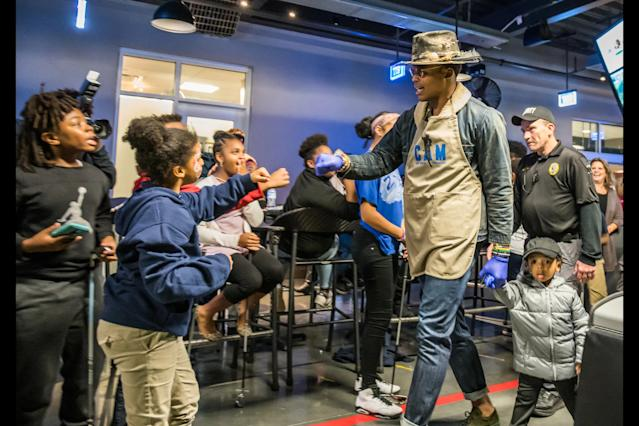 Keep pounding: Cam Newton welcomed 1,200 children for his seventh annual Thanksgiving Jam on Monday night. (Panthers/Instagram)