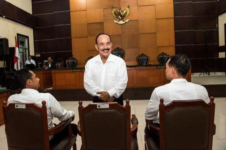The leader of Gafatar group Ahmad Musadeq stands as he smiles during trial at East Jakarta district court in Indonesia, March 7, 2017 in this photo taken by Antara Foto. Picture taken March 7, 2017. Antara Foto/M Agung Rajasa/ via REUTERS