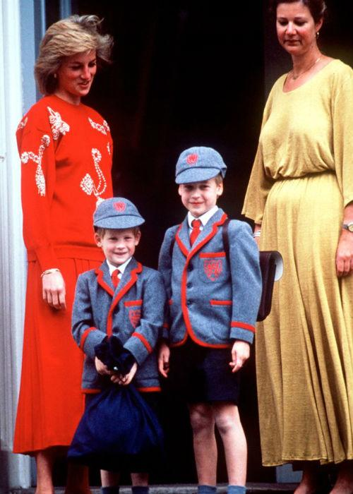 Princess Diana with Princes William and Harry in identical uniforms on Prince Harry's first day of school on September 12, 1989.