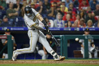 Pittsburgh Pirates' Kevin Newman drives in a run with a grounder off Philadelphia Phillies relief pitcher Hector Neris during the ninth inning of a baseball game Tuesday, Aug. 27, 2019, in Philadelphia. Newman was safe at first on an error by first baseman Rhys Hoskins. Pittsburgh won 5-4. (AP Photo/Matt Slocum)