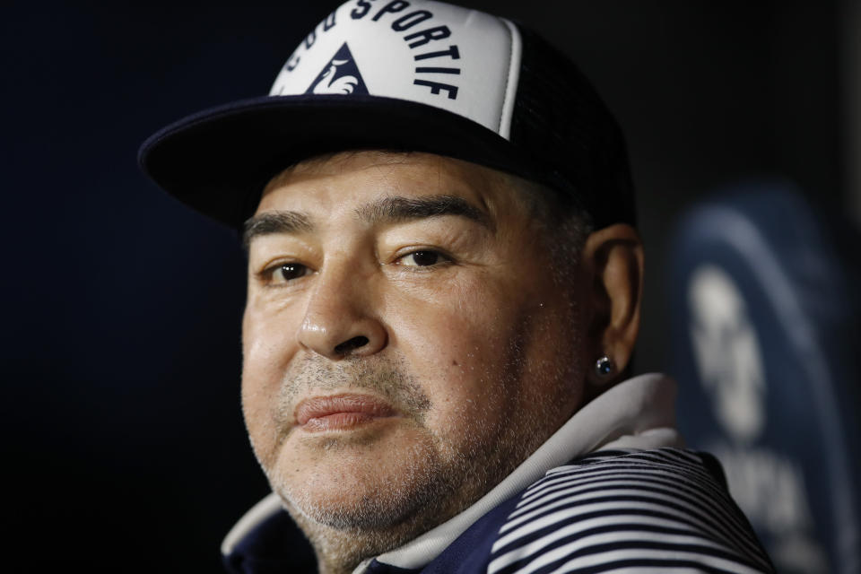 FILE - In this March 7, 2020 file photo, Diego Maradona, coach of Gimnasia y Esgrima, sits on the bench prior to Argentina's soccer league match against Boca Juniors at La Bombonera stadium in Buenos Aires, Argentina. Maradona turns 60 on Friday, Oct. 30, 2020. (AP Photo/Natacha Pisarenko, File)