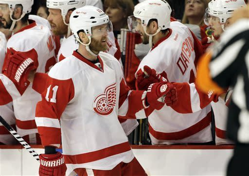 Detroit Red Wings' Daniel Cleary (11) celebrates with teammates after scoring a goal against the Chicago Blackhawks during the second period of Game 5 of the NHL hockey Stanley Cup playoffs Western Conference semifinals in Chicago, Saturday, May 25, 2013. (AP Photo/Nam Y. Huh)
