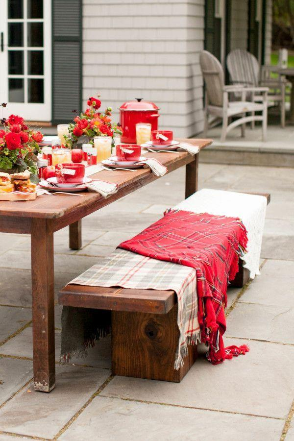 """<p>For an outdoor fall meal, take inspiration from <a href=""""https://urldefense.proofpoint.com/v2/url?u=http-3A__www.stylemepretty.com_living_&d=CwMF-g&c=B73tqXN8Ec0ocRmZHMCntw&r=1SKxxQCjta-pWEjaI7W4C1a9YhNhSr750SSHCTkjllE&m=RtIo9GQUy1khEGYgp_dhLgF7iED4v2a3drSrbCL13b0&s=gVfpQOnoKGz3oWUyfRWbe1qJQOcxkSJRSRv8QjqobQY"""" rel=""""nofollow noopener"""" target=""""_blank"""" data-ylk=""""slk:Style Me Pretty Living"""" class=""""link rapid-noclick-resp"""">Style Me Pretty Living</a> founder and editor Abby Larson and cover seating with <a href=""""https://www.elledecor.com/design-decorate/room-ideas/a9195/how-to-make-large-knit-blanket/"""" rel=""""nofollow noopener"""" target=""""_blank"""" data-ylk=""""slk:warm-hued blankets"""" class=""""link rapid-noclick-resp"""">warm-hued blankets</a> that keep the style (and your guests) cozy. </p>"""