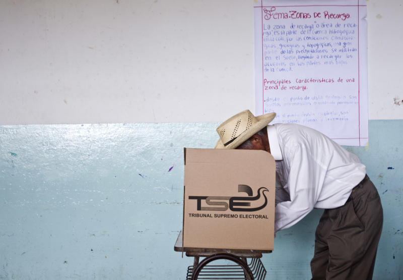A man votes at a polling station during the presidential runoff election in Panchimalco, on the outskirts of San Salvador, El Salvador, Sunday, March 9, 2014. Salvadorans head to the polls Sunday to elect their next president in a runoff between former Marxist guerrilla Salvador Sanchez Ceren from the ruling Farabundo Marti National Liberation Front (FMLN), and former San Salvador Mayor Norman Quijano from the Nationalist Republican Alliance (ARENA). (AP Photo/Esteban Felix)