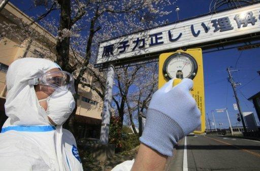 "A man checks the radiation level at Futaba town, in Fukushima prefecture, within 10km from the stricken Tokyo Electric Power Co (TEPCO) Fukushima nuclear power plant on April 17, 2011. The documentary film ""Nuclear Nation"" focuses on the exile of residents of Futaba, where the crippled Fukushima plant was based"