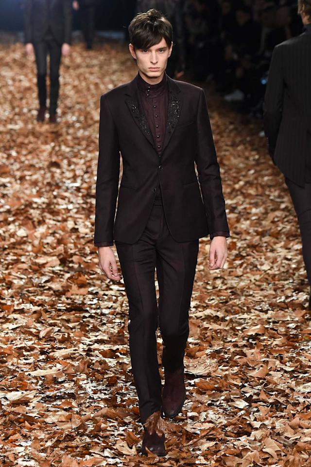 <p>Varvatos considers himself the king of rock and roll design. This monochromatic number features a bit of embroidery on the lapel that keeps it from being too traditional. </p>