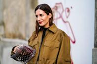 <p>Model carries the Valetino Rockstud Spike Medium Quilted Shoulder Bag. (Photo: Getty Images) </p>