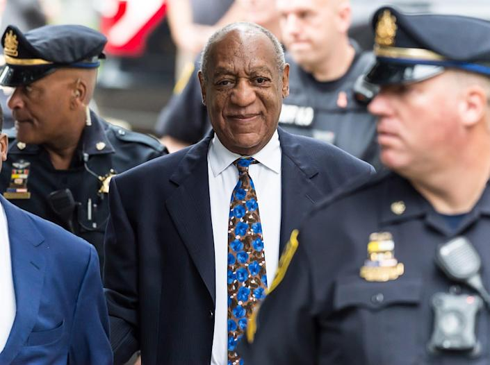 Bill Cosby surrounded by police.