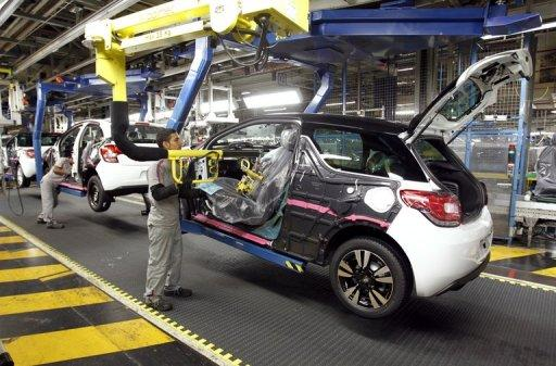 Employees are at work on the Citroen DS3 production line at the French automaker PSA Peugeot-Citroen plant in Poissy near Paris, January 2012. France will boost support for environmentally friendly cars as part of a recovery plan to be unveiled amid growing concern for the country's crisis-hit auto industry and top carmaker Peugeot
