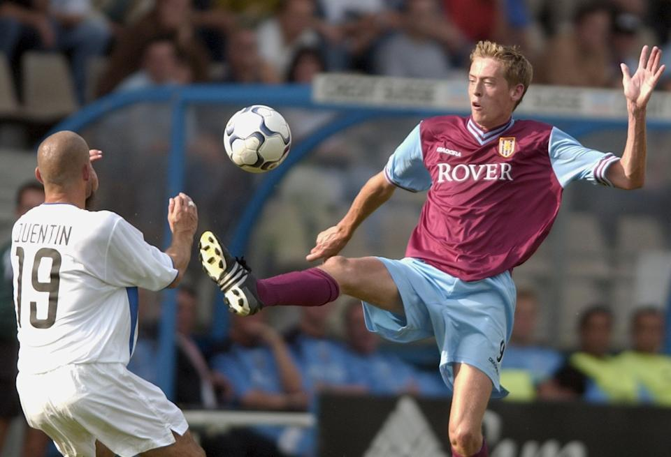 Aston Villa's Peter Crouch, right, fights for the ball with Zurich's Yvan Quentin, left, during the UEFA Intertoto Cup soccer match between FC Zurich and Aston Villa, on Sunday, July 21, 2002, in Zurich, Switzerland. (AP Photo/Keystone, Gaetan Bally)