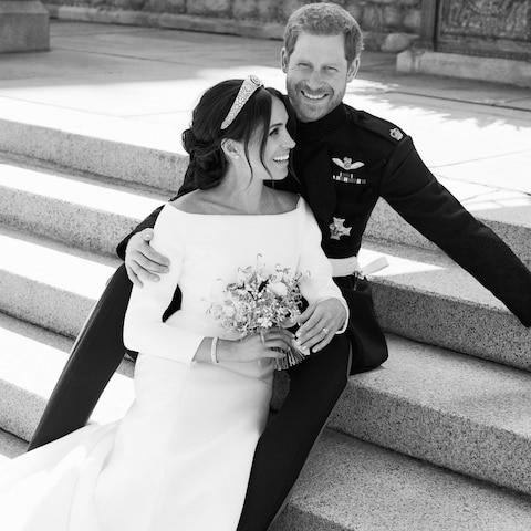 A black and white photograph of Prince Harry and Meghan Markle - the new Duke and Duchess of Sussex - Credit: Alexi Lubomirski/Kensington Palace