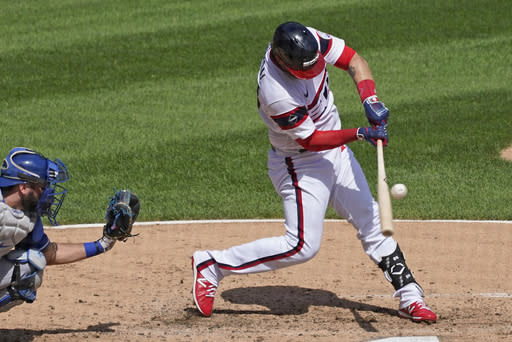 Chicago White Sox's Yasmani Grandal hits a single against the Kansas City Royals during the third inning of a baseball game in Chicago, Sunday, Aug. 30, 2020. (AP Photo/Nam Y. Huh)